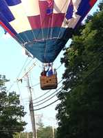 A hot air balloon with four people inside got tangled in power lines in Hampstead Friday morning.