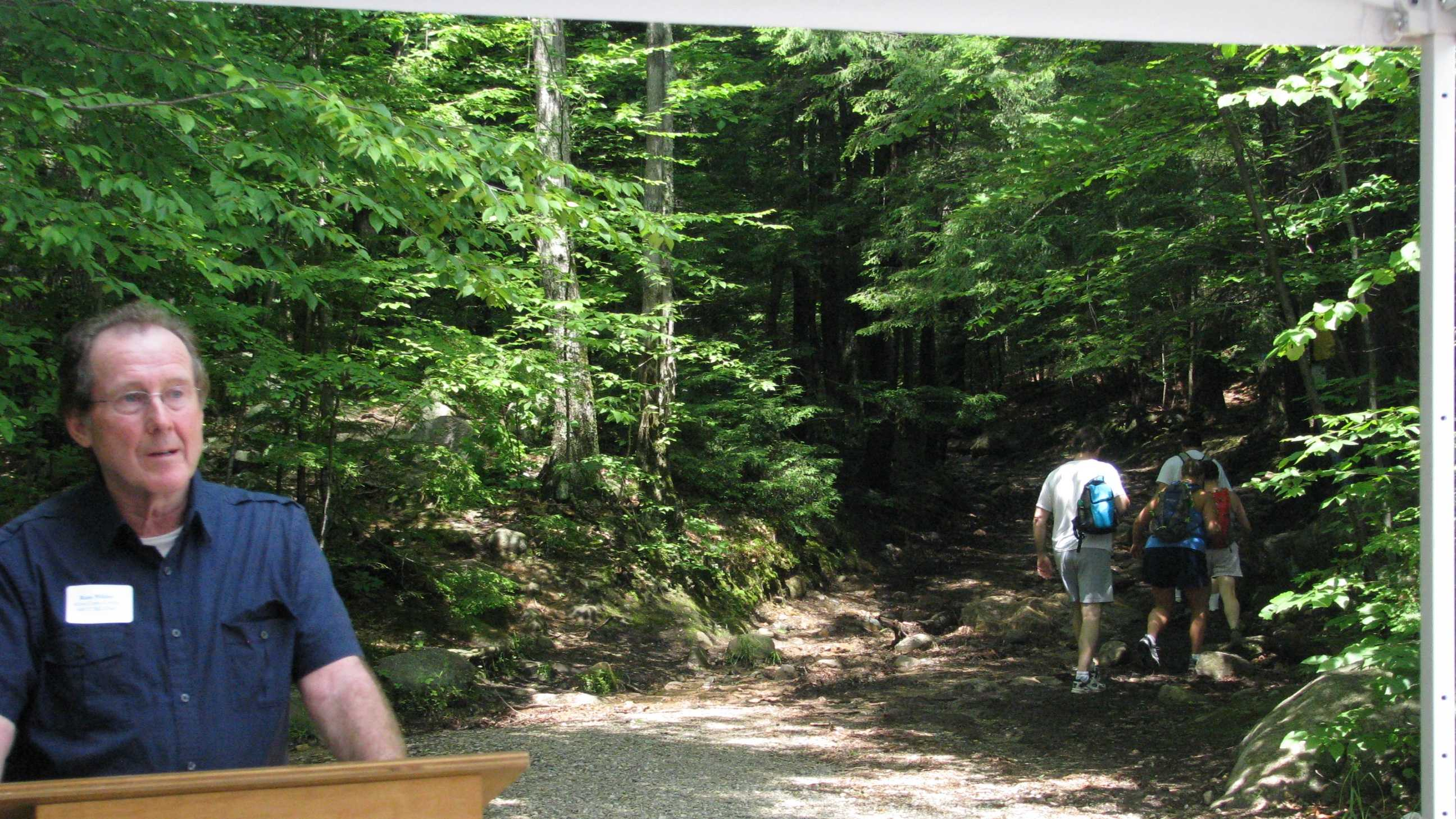 Russ Wilder, chair of the Belknap Range Conservation Coalition speaks about the importance of protecting Mount Major at a press conference at the trail head in Alton, Tuesday.