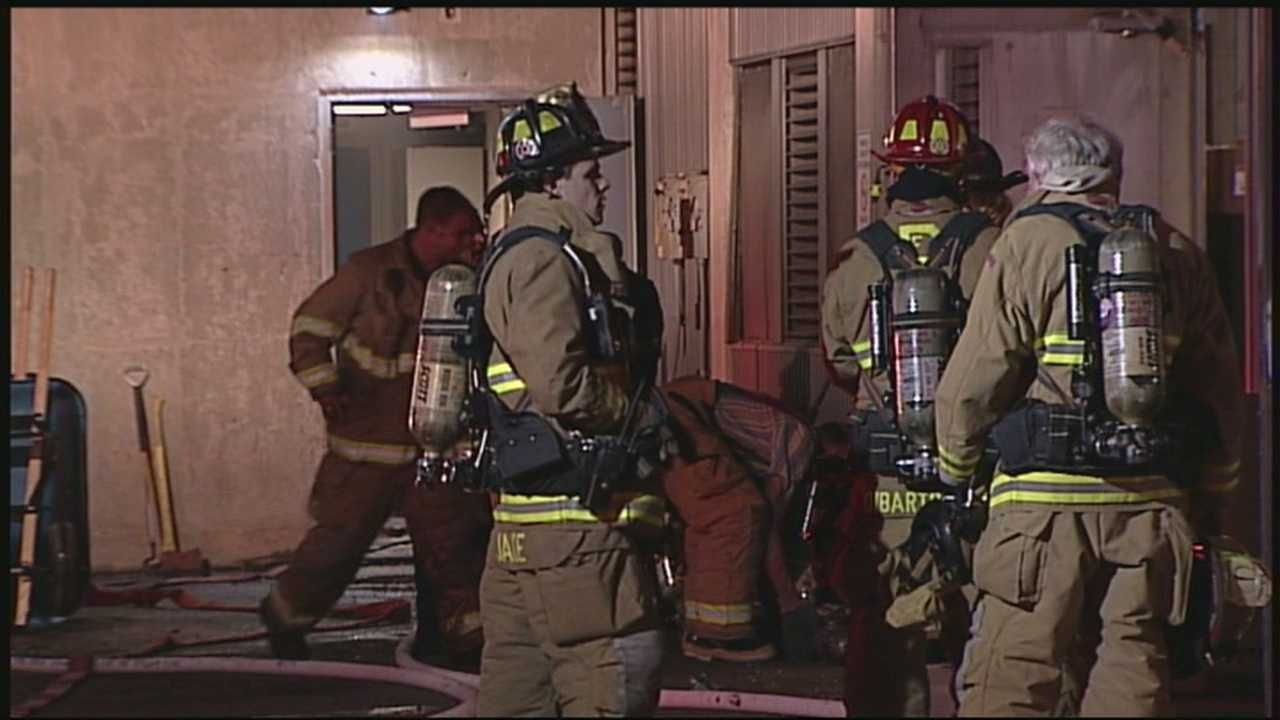 Police clean up after fire