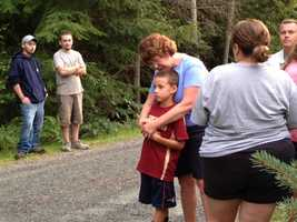 The search for a missing boy in Goshen ended with a tearful, happy embrace as 7-year-old Brennan Pelletier returned to the arms of his aunt, who had been worrying for nearly five hours.