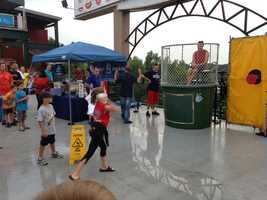 WMUR News 9 veterans participated in a dunk tank during the event.