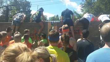 Teamwork begins immediately when Mudders make their way over a series of walls on an obstacle called Glory Blades.