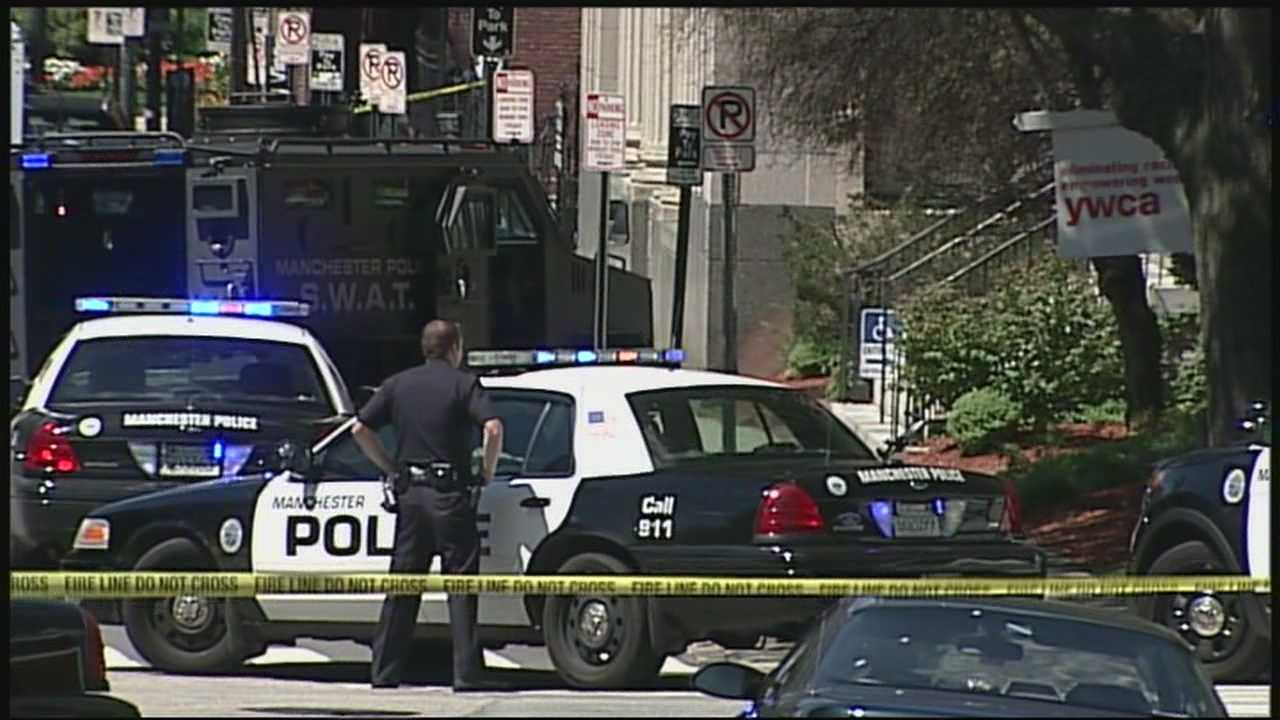 A man shot and killed his son before taking his own life at the YWCA in Manchester on Sunday morning, police said.