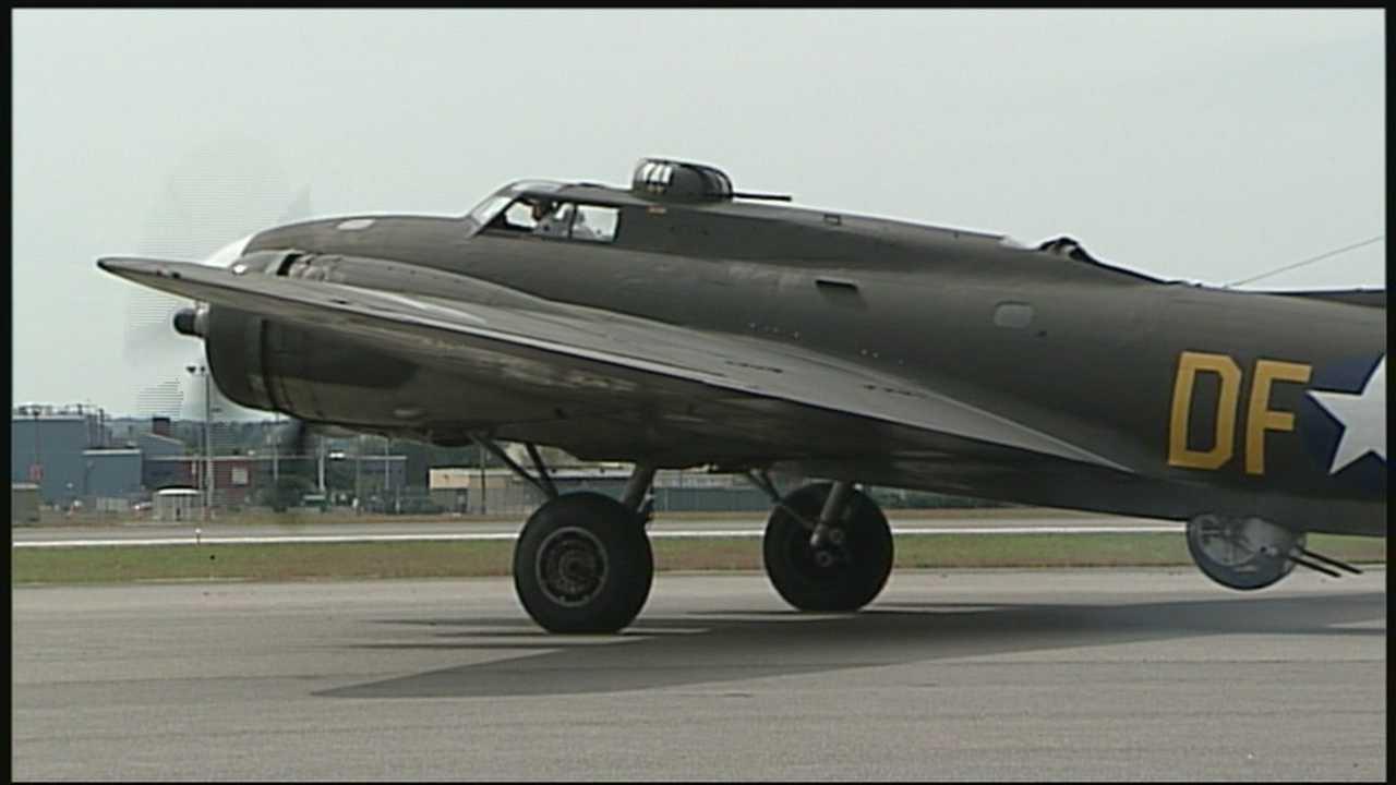 Vintage bomber flies over Manchester