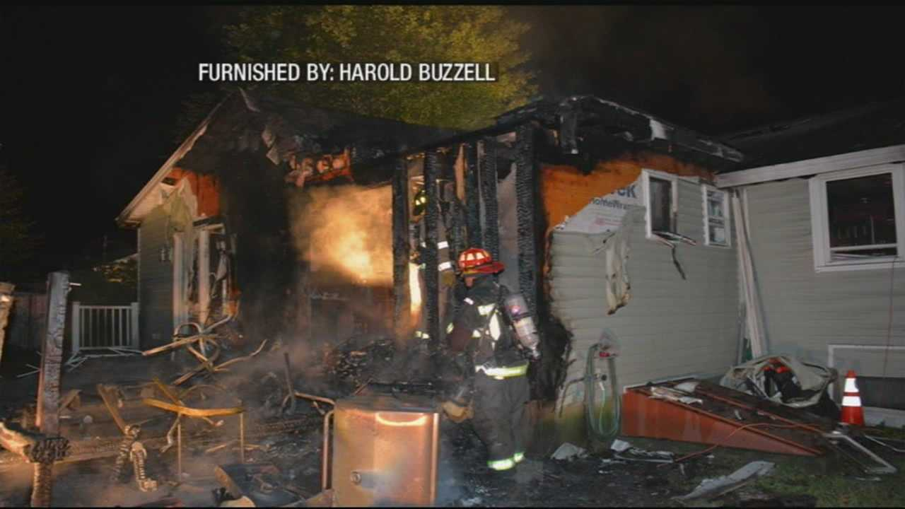 Firefighter battles a fire at his own house.