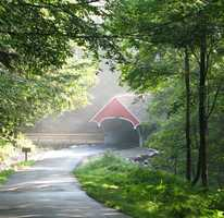 The Flume Covered Bridge was built in the 1886 and has been restored several times.