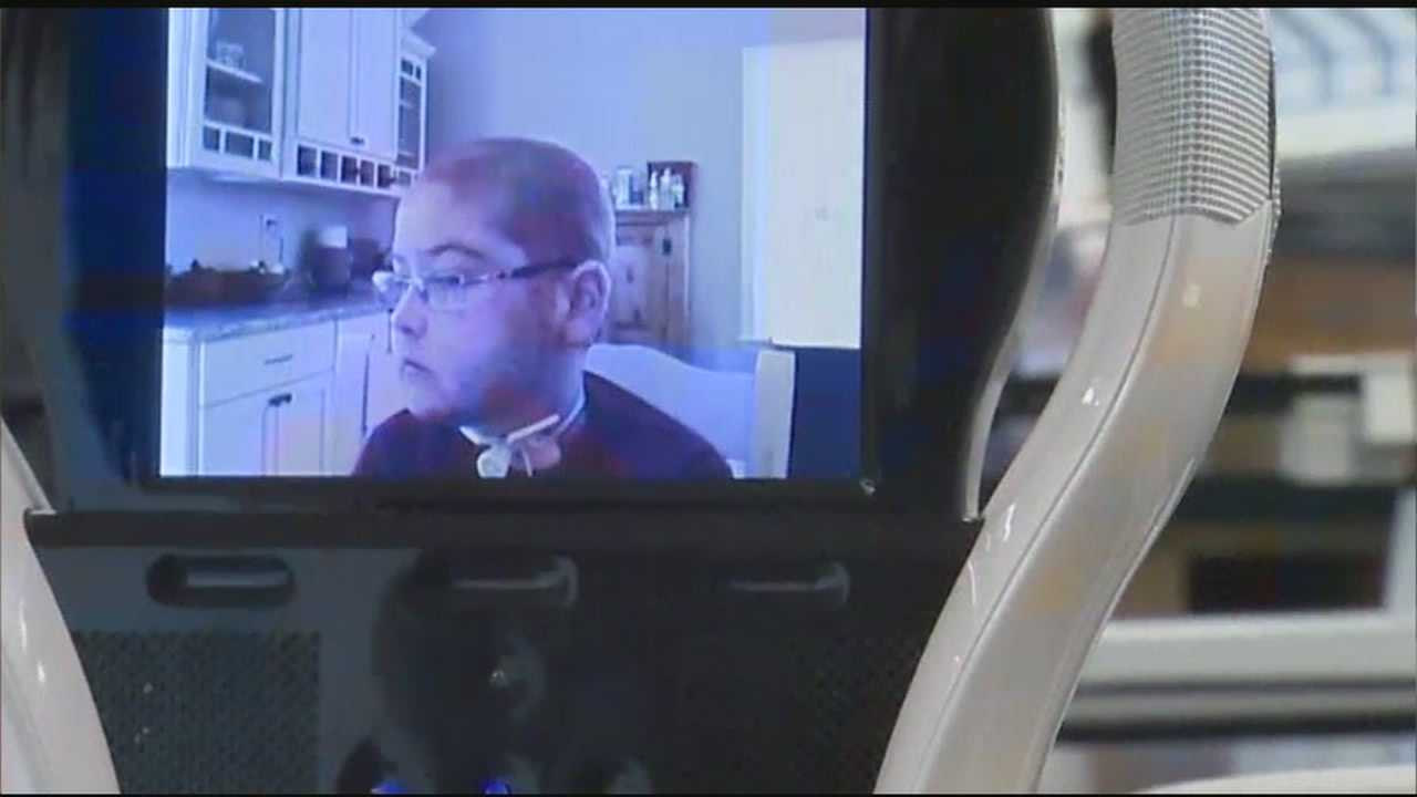 A robot created by a Nashua company is helping a cancer survivor stay in Tyngsborough High School.