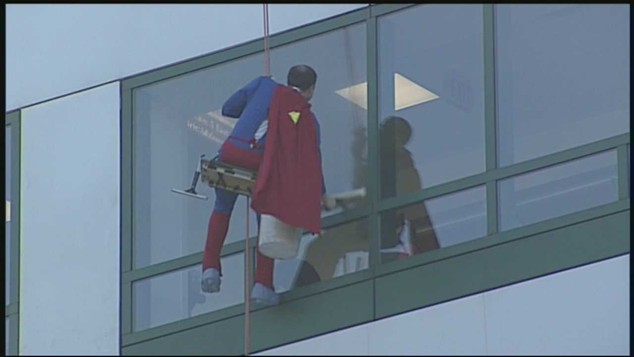 Superman and Captain America took some time to wash the windows at the Children's Hospital at Dartmouth on Thursday.