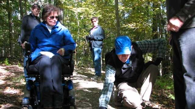Janet Zeller, national accessibility program manager with the U.S. Forest Service, and conference attendee Stephen Legge of The Groton Trails Committee in Groton, Mass. measure the slope of the trail at several different angles at Crotched Mountain's new trail system.