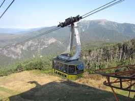 First passenger aerial tramway -The Cannon Mountain Tramway, which opened to the public in 1938, in Franconia, New Hampshire, is a double reversible tram system that makes a 2,022-foot vertical ascent in under 8 minutes.