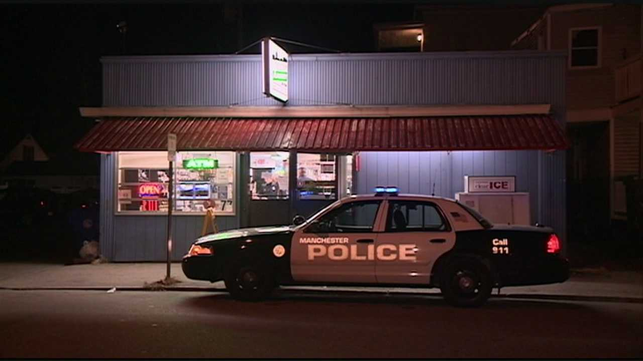 Police caught a man robbing a store in Manchester on Thursday night.