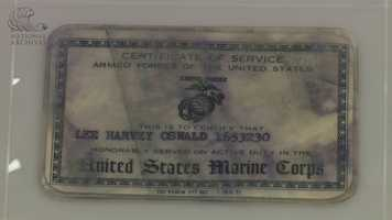 A United States Marine Corps certificate of service card