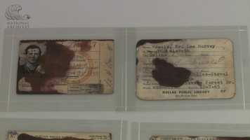 A military identification card and a Dallas Public Library Card. Some of the items were stained by chemicals used for fingerprinting.