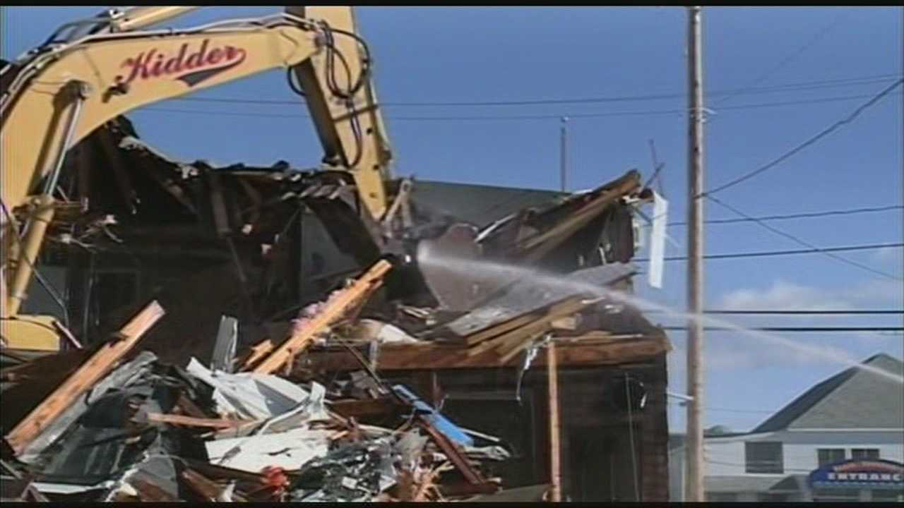 Excavator takes down old Hampton fire building