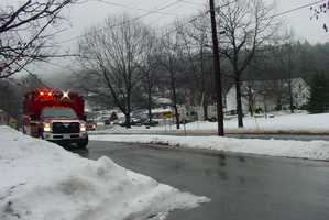 A fire ripped through a building in Henniker on Monday.