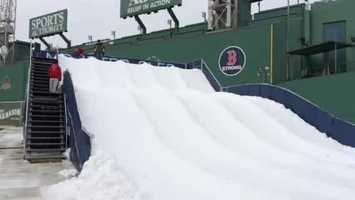 As part of the Frozen Fenway event, a massive snow slide has been built from the Green Monster.