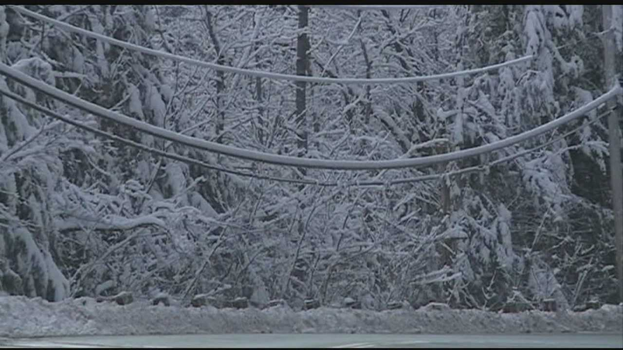 Snow piles high on power lines