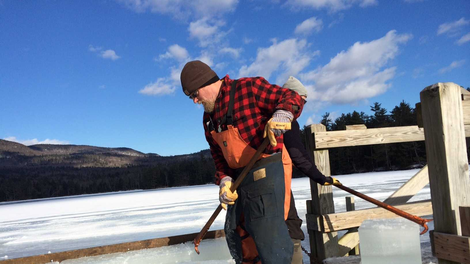 Workers cut 150-pound blocks of ice on Squam Lake.
