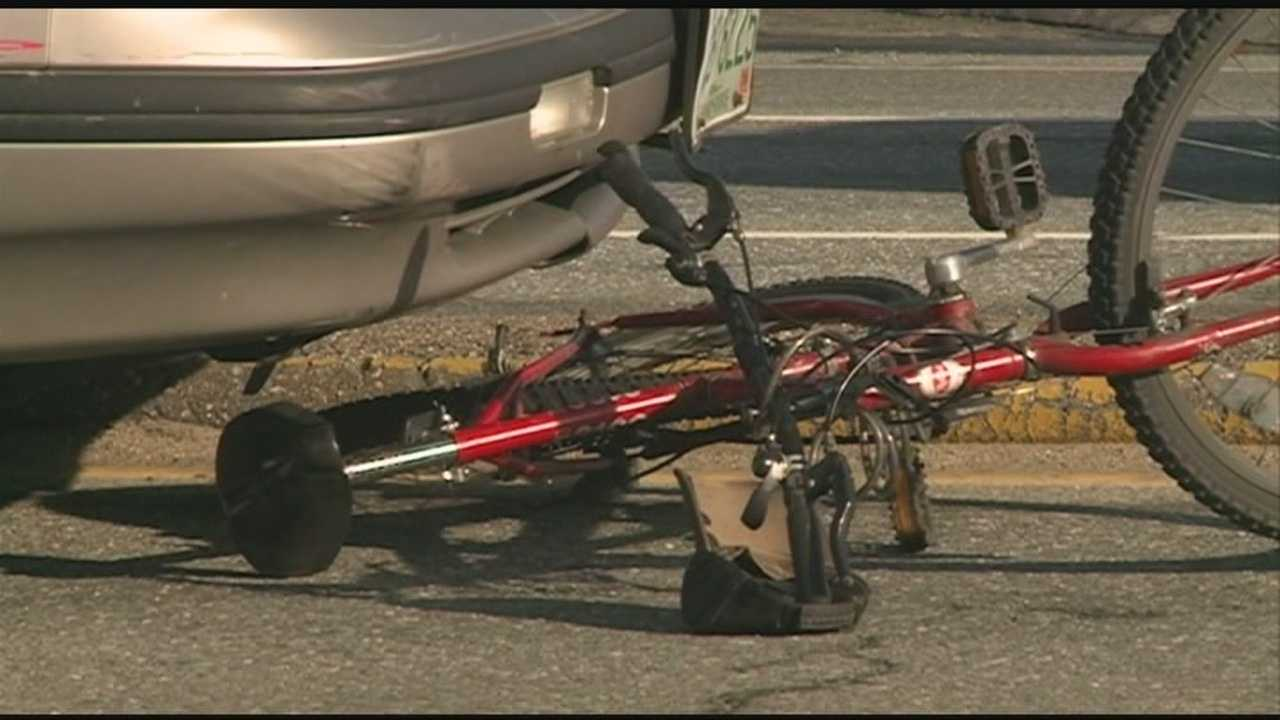 Man struck while walking bicycle across street