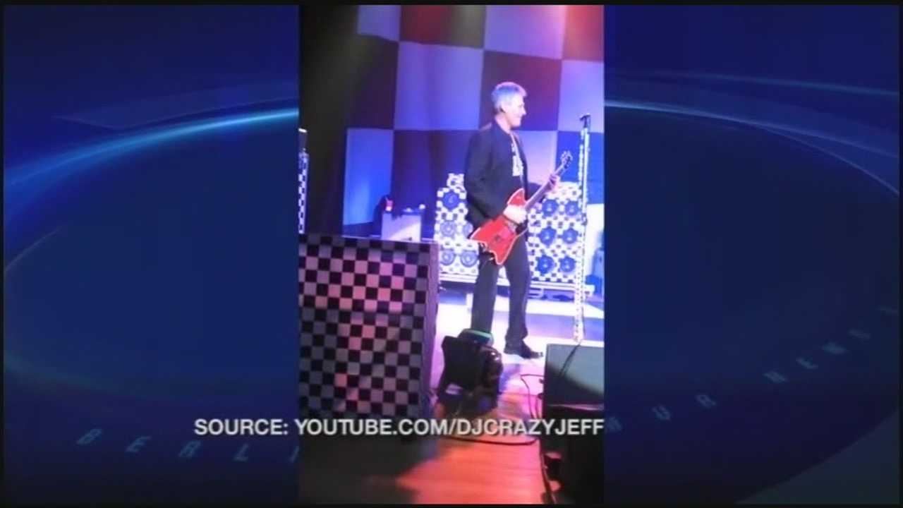 Scott Brown sings on stage with Cheap Trick