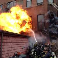 Officials say two firefighters killed by a fast-moving, wind-driven fire that ripped through a Boston brownstone died after they were trapped in the basement.