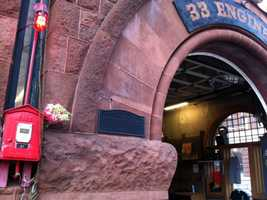 Flowers left at Engine 33 on Boylston Street, where the firefighters worked.
