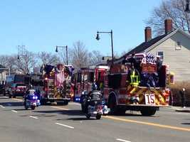 Ladder 15 takes Michael Kennedy's body down Centre Street.