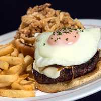 Breakfast Burger - Handmade burger topped with fried egg, fresh mozzarella cheese, sautéed onions and chipotle sauce