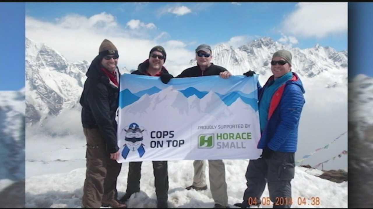 Hikers fly flag on Nepalese peak