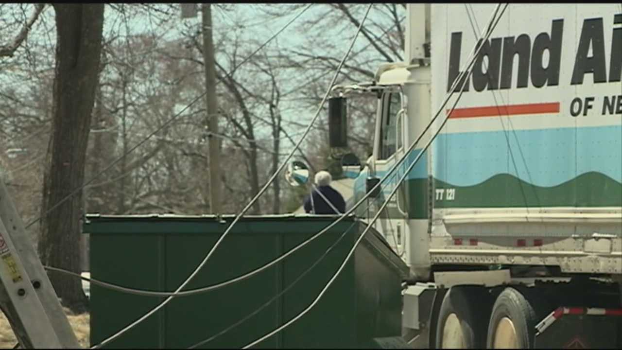 Truck brings down power lines