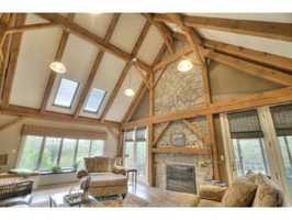 It includes a Great Room and three fireplaces.