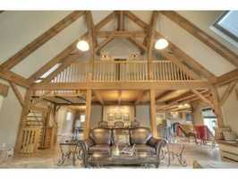 The home features post-and-beam style architecture and cathedral ceilings.