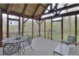 The home features a screen porch and a deck.