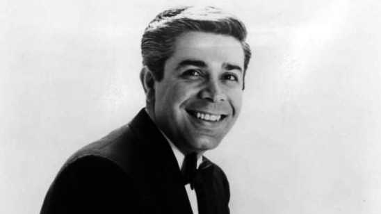 """Born Genaro Louis Vitaliano, Jerry Vale started performing in New York supper clubs as a teenager and went on to record more than 50 albums. He was known for his high tenor voice and romantic songs, including his signature tune """"Al Di La."""" (July 8, 1932 – May 18, 2014)"""