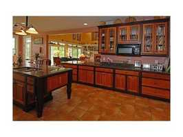 The home features cherry cabinets and hardwood floors.