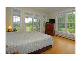 The home includes four bedrooms, four full bathrooms and one half bath.