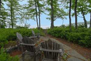 The land has a point, two docks, and a beautiful beach with walk-in sandy frontage. This is perfect for three generations including little ones.