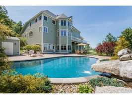 The property also has an in-ground pool, hot tub and attached three-car garage.