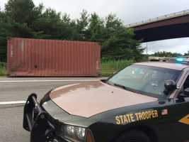 A tractor-trailer rolled over on I-93 southbound during the morning commute Thursday.