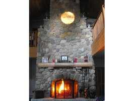 One of the interior highlights is this two-story stone fireplace.