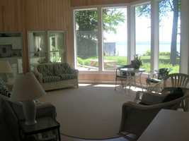 She said the house is really two in one with two kitchens, joined by a lovely glassed-in room facing the big lake.