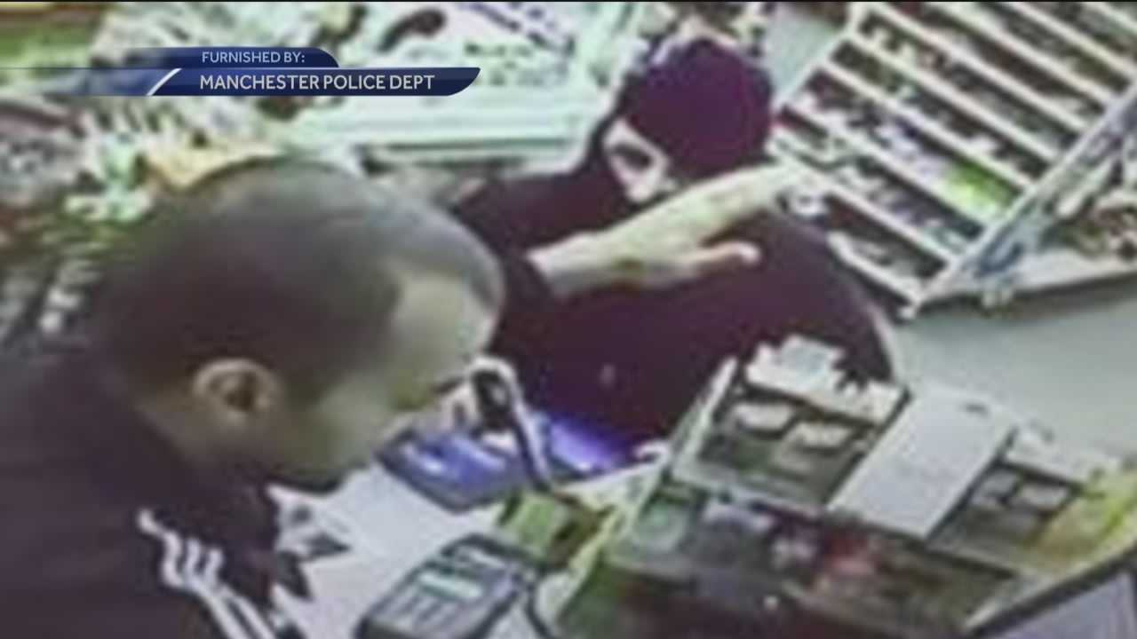 Manchester clerk scuffles with robber armed with gun