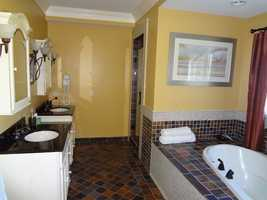 There is a whirlpool tub and steam bath in one of the bathrooms and two and a half other baths in the house.