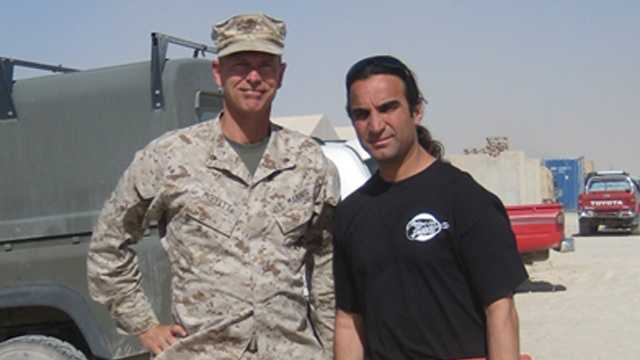 Lt. Col. Mike Moffett of Concord in Afghanistan with Fahim Fazli in 2010.