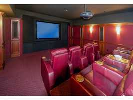 The in-home theater seats 8 people.