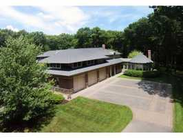 Built in 2002, the home is comprised of brick and stone and has a 3-car garage.