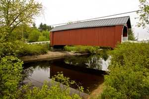 Carleton Bridge in Swanzey, N.H.The current bridge was constructed in 1869.When the original bridge was built, a wagon full of hay was used as a standard for the height and width of the opening.