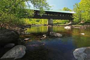 Rowell's Bridge in Hopkinton, N.H.Constructed in 1853.Shortly after the bridge was constructed, a herd of cattle traveled too fast across it, and moved it off its abutments.