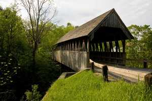 Meriden Bridge in Plainfield, N.H.Constructed in 1880.The current bridge is the third one on this site. Itis thought to be the first covered bridge in New Hampshire to be repaired under the state's Town Bridge Aid program.