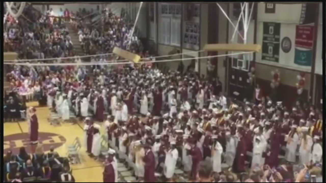 """The Class of 2015 broke into a flash mob during its graduation ceremony on Friday, dancing to Taylor Swift's song """"Shake it Off."""""""